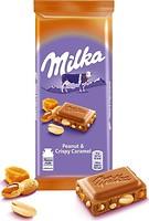 Фото Milka молочный с арахисом, кусочками карамели, рисовыми шариками и кукурузными хлопьями 90 г